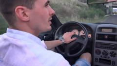 Couple driving convertible car cabriolet steadicam shot. UHD 4K stock footage Stock Footage