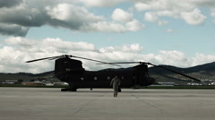 Time lapsed, soldiers inspecting a CH-47 Chinook Helicopter. Stock Footage