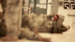 Shot coming into focus showing soldiers lying on the ground. Stock Footage