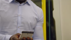 4k, handsome man on smartphone on subway train.  - stock footage