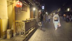 Timelapse of a Geisha walking down streets of the Gion district of Kyoto Stock Footage