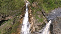 Agoyan waterfall in Ecuador twin waterfall camera tilt slow motion Stock Footage