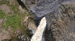 Slow motion camera tilt over Agoyan waterfall in Ecuadorian Andes Stock Footage