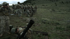 Slow motion clip of soldier shooting suppressed automatic weapon. Stock Footage