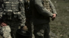 Slow motion shot from behind of soldiers firing mortar, mortar remaining - stock footage