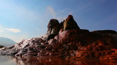 Static shot of the spraying water and colorful deposits of the Fly Geyser in Stock Footage
