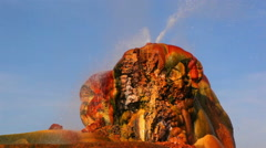 Shot of hot water spouting out of the colorful rock formation at Fly Geyser, Stock Footage