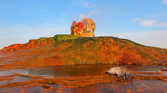 Wide shot of Fly Geyser in Nevada. Water spouts from colorful rocks to slopes Stock Footage