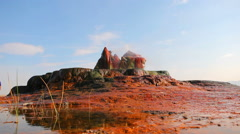 Wide shot of the colorful rocks and water spouts at Fly Geyser, Nevada. Stock Footage