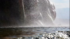 Close-up shot of the splashing surface of a pond at the base of Fly Geyser in Stock Footage