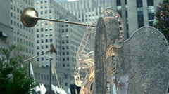 Angel decoration and Christmas tree in Rockefeller Center, New York. - stock footage