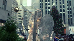 Christmas tree and angel decoration at Rockefeller Center, New York City. - stock footage