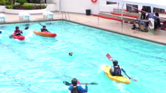 Kayak water ball game in Santa Ana pool for summer contest Stock Footage