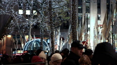 Christmas tree with lights and crowd of people in New York. - stock footage