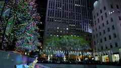 Christmas fountain, ice rink, and flags in New York City. - stock footage