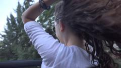 Beautiful brunette have fun riding in a convertible cabriolet car, freedom co Stock Footage
