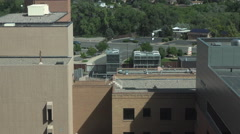 Hospital window to buildings and road fast 4K Stock Footage
