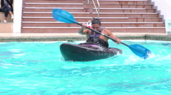 Kayaker performing consecutives rolls for Santa Ana summer contest Stock Footage