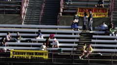 Spectators at a school track and field event. Stock Footage