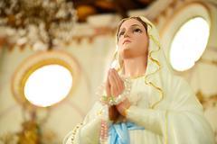 Statues of Holy Women in Roman Catholic Church - stock photo
