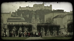 Tour group below castle. Vintage stylized video clip. Stock Footage