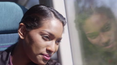 4k Beautiful woman looking out of window and falling asleep on train journey - stock footage