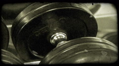 Pan large barbells. Vintage stylized video clip. Stock Footage