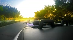 Cabriolet convertable car drive with summer sunset shine at background. UHD 4 - stock footage
