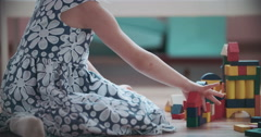 Little Girl Playing with Toy Blocks - stock footage