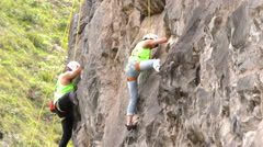 Two rock climbers during competition - stock footage