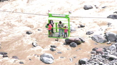 Cable car with tourists crossing over Pastaza river in Ecuador Stock Footage