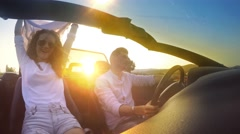 Couple in convertible car with sunset sun rays shining, Car, Convertible, Fun Stock Footage