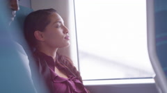 4k Beautiful woman looking out of window and falling asleep on train journey Stock Footage
