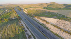 Car travel on vacation. Aerial shot of amazing green landscape, road traffic Arkistovideo