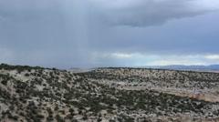 Desert thunderstorm pan across arid desert landscape. - stock footage