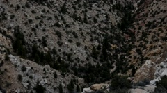 Pan up from deep desert canyon into thunderstorm sky. Stock Footage