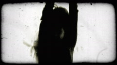 Silhouette of a dancing young woman. Vintage stylized video clip. Stock Footage