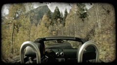 Man drives on mountain road in fall. Vintage stylized video clip. Stock Footage
