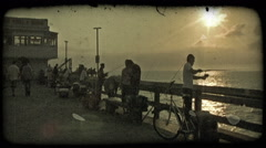 People fish off pier. Vintage stylized video clip. Stock Footage