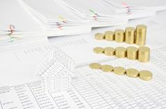 House and group step of gold coins on finance account Stock Photos