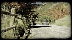 Car drives on mountain road. Vintage stylized video clip. Stock Footage