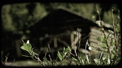 Old log cabin. Vintage stylized video clip. Stock Footage
