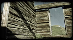 Old cabin in mountains. Vintage stylized video clip. Stock Footage
