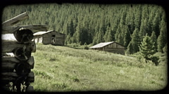 Old cabin remains in mountains. Vintage stylized video clip. Stock Footage