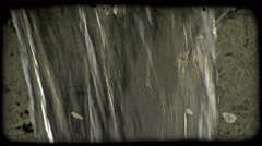 Clear water falling off ledge. Vintage stylized video clip. Stock Footage