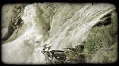 Heavy waterfall. Vintage stylized video clip. - stock footage
