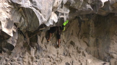 Stock Video Footage of Ecuadorian rock climbing champion during Basalt of Tungurahua competition