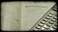 Close-up pan of math textbook and graphing calculator. Vintage stylized video Stock Footage
