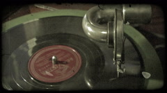 Close-up footage of record spinning on record player. Vintage stylized video Stock Footage