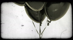 Black balloons with tilting shot. Vintage stylized video clip. Arkistovideo